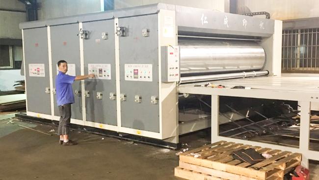 在送纸过程中是怎样使用印刷开槽机?